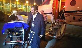 Jews wounded in Brussels arrive in Israel