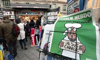 France: Charlie Hebdo cartoons projected onto gov't building