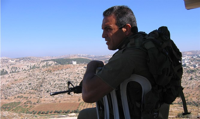 Reserve soldier guarding in Hevron