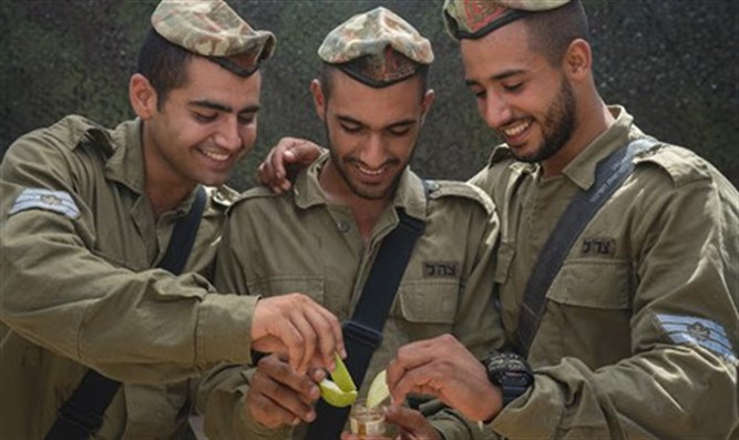 Soldiers enjoy apples dipped in honey
