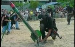 Hamas terrorist launching rocket at Israel