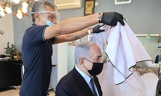 Netanyahu gets haircut: 'Let's go strengthen small business.'