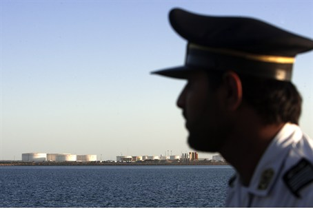 A security officer looks on at oil docks east