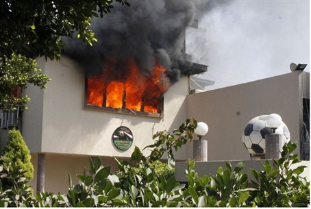 Flames rise from a room at the headquarters o