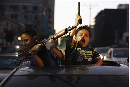 Palestinian children in Gaza celebrate ceasef