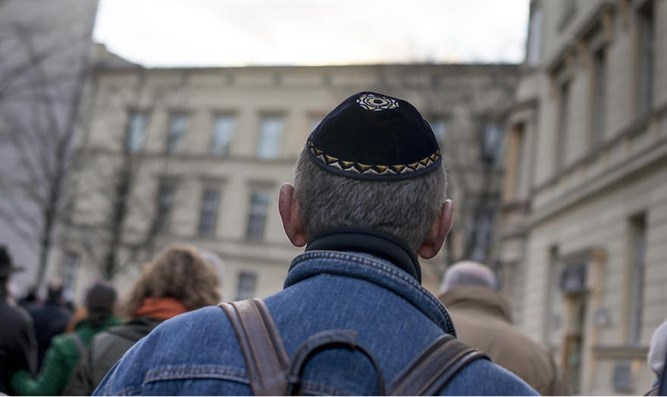 Kippah-clad man during Holocaust remembrance march