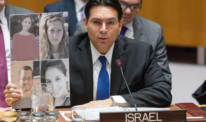Danon with the pictures of the murdered soldiers