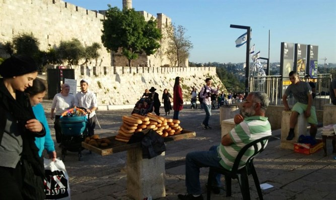 Selling bread at Jaffa Gate, Passover