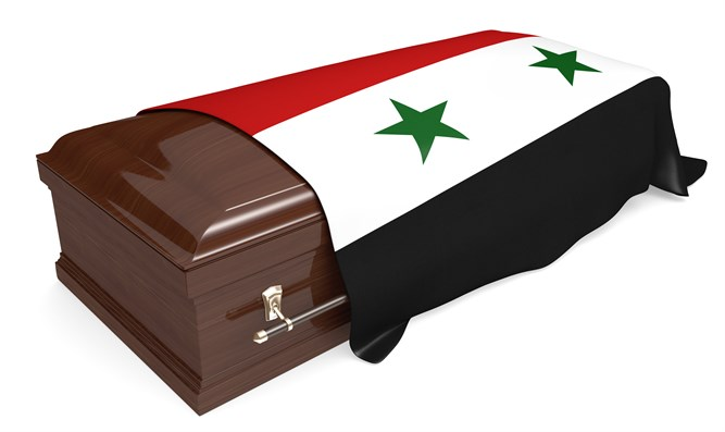 Coffin draped by Syrian national flag