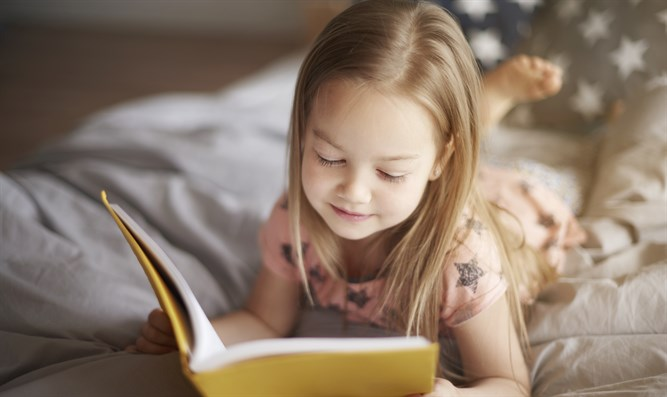 Girl reading book (illustrative)