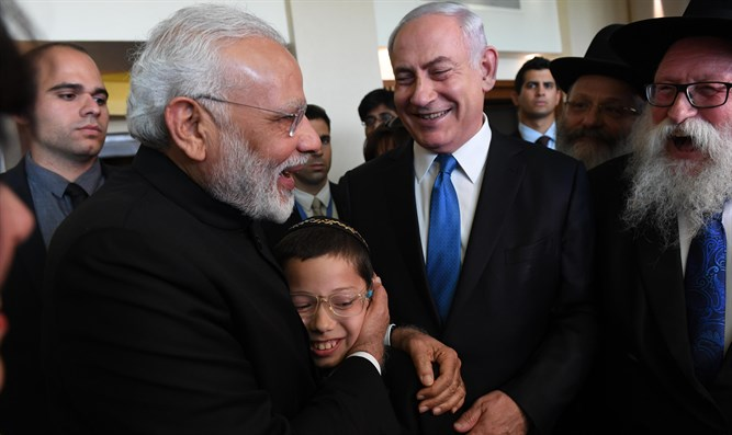 Moshe Holtzberg with PM Netanyahu and Indian PM Narendra Modi