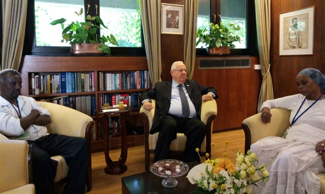 Rivlin with Avera Mengistu's family