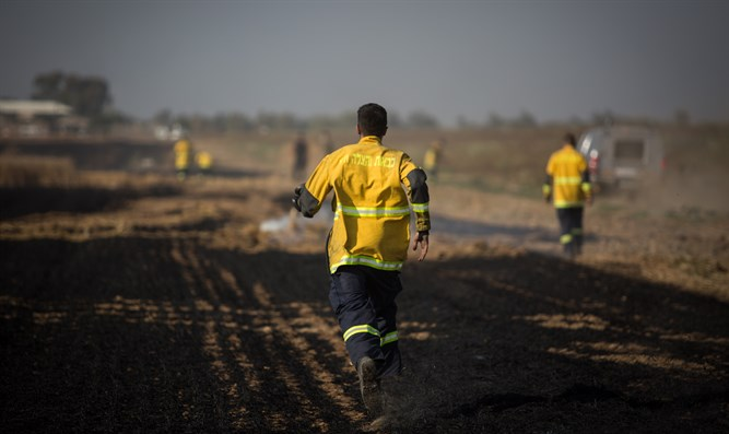 Firefighters run to extinguish Gaza area fire