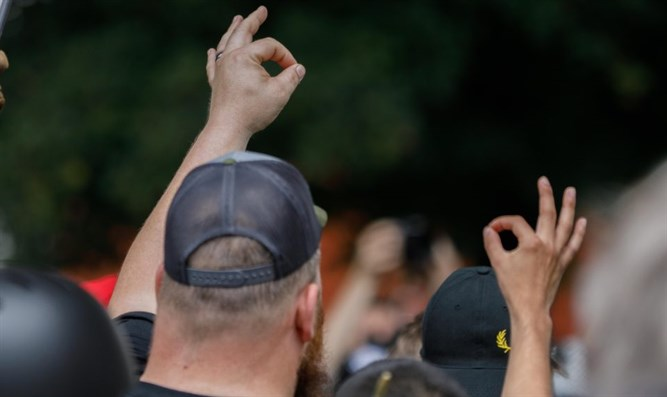 "Members of 'Proud Boys' group make the ""OK"" gesture at a rally in Portland"