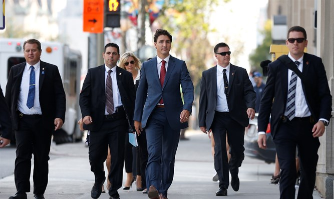 Trudeau flanked by RCMP security detail
