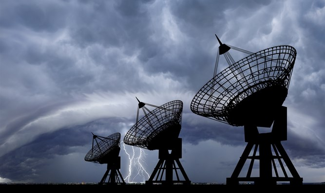 Stormclouds gather over satellite dish array