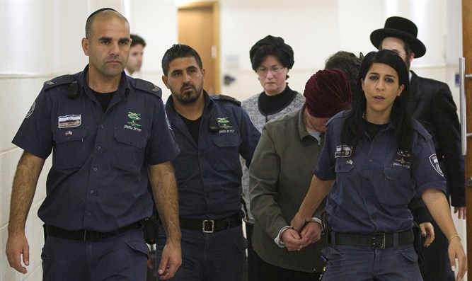 Malka Leifer led by prison service officers in Jerusalem court