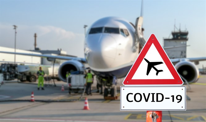COVID-19 sign in front of plane